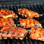 ribs on the grill with bbq sauce