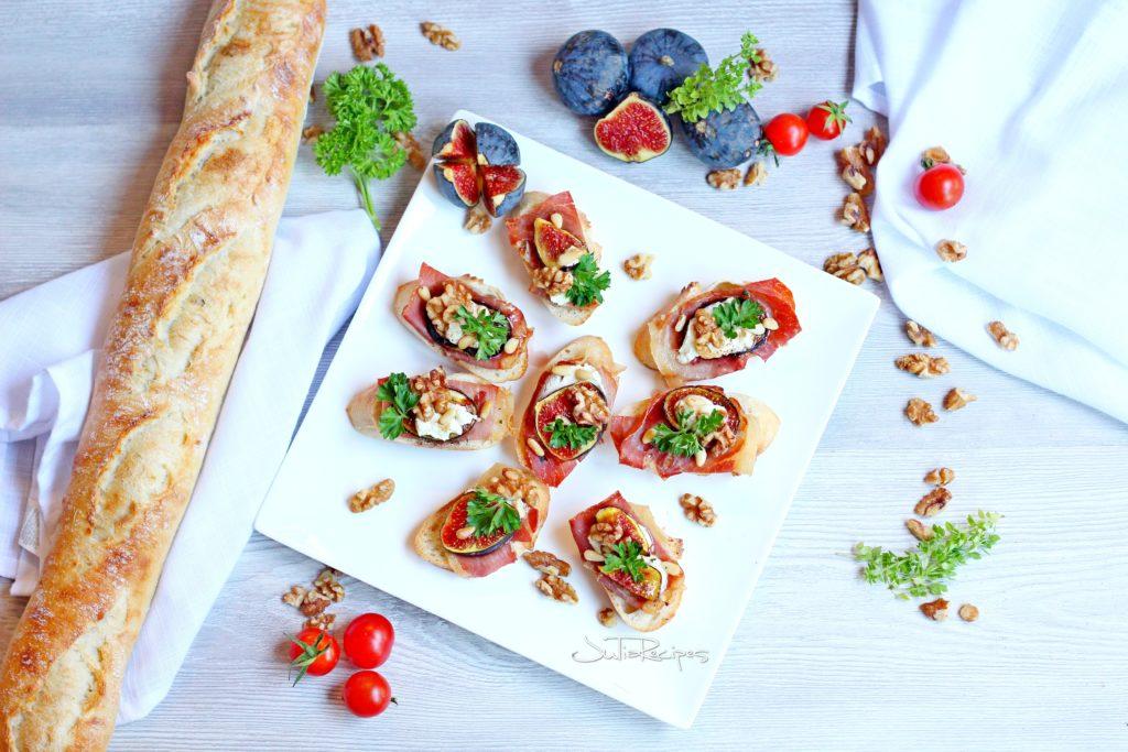prosciutto crostini place on white plate