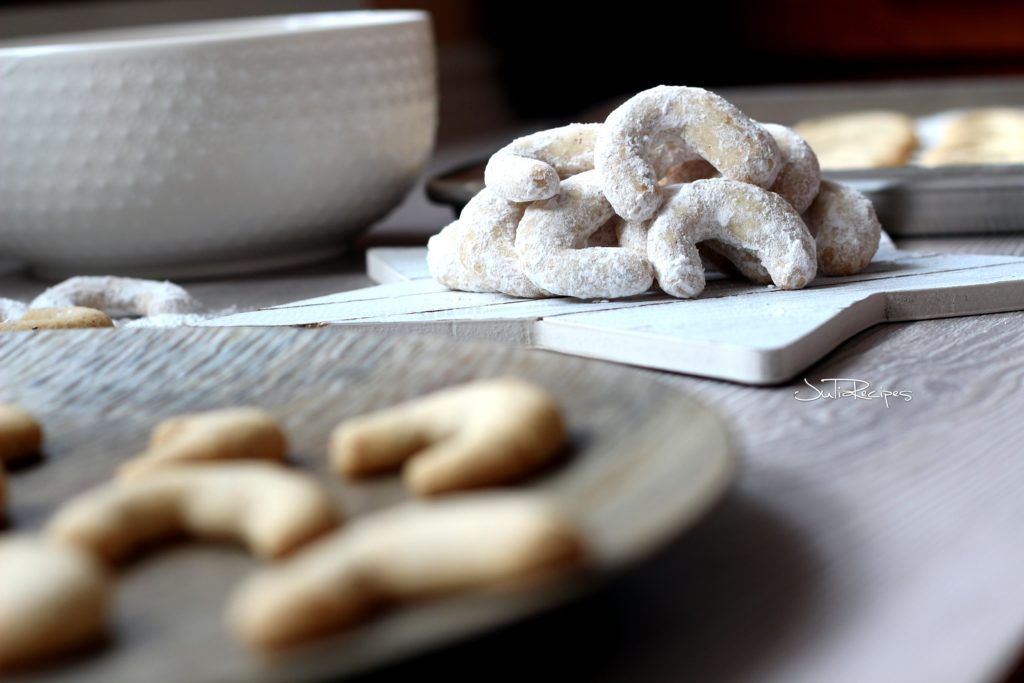 close up on hazelnut crescents covered in icing sugar