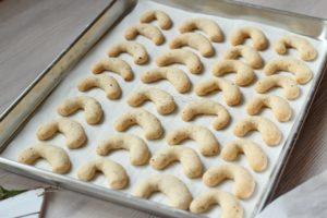 hazelnut crescents on baking dish