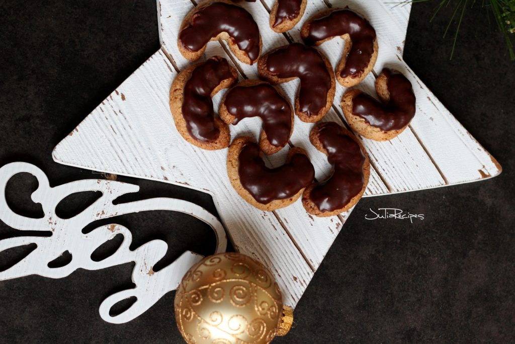 cookies in crescent shape on white star board