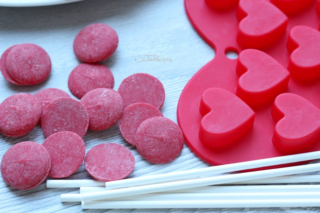 red candy melts with pop sticks and heart mould