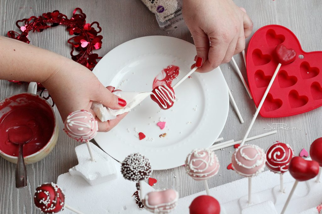 red heart cake pop being decorated