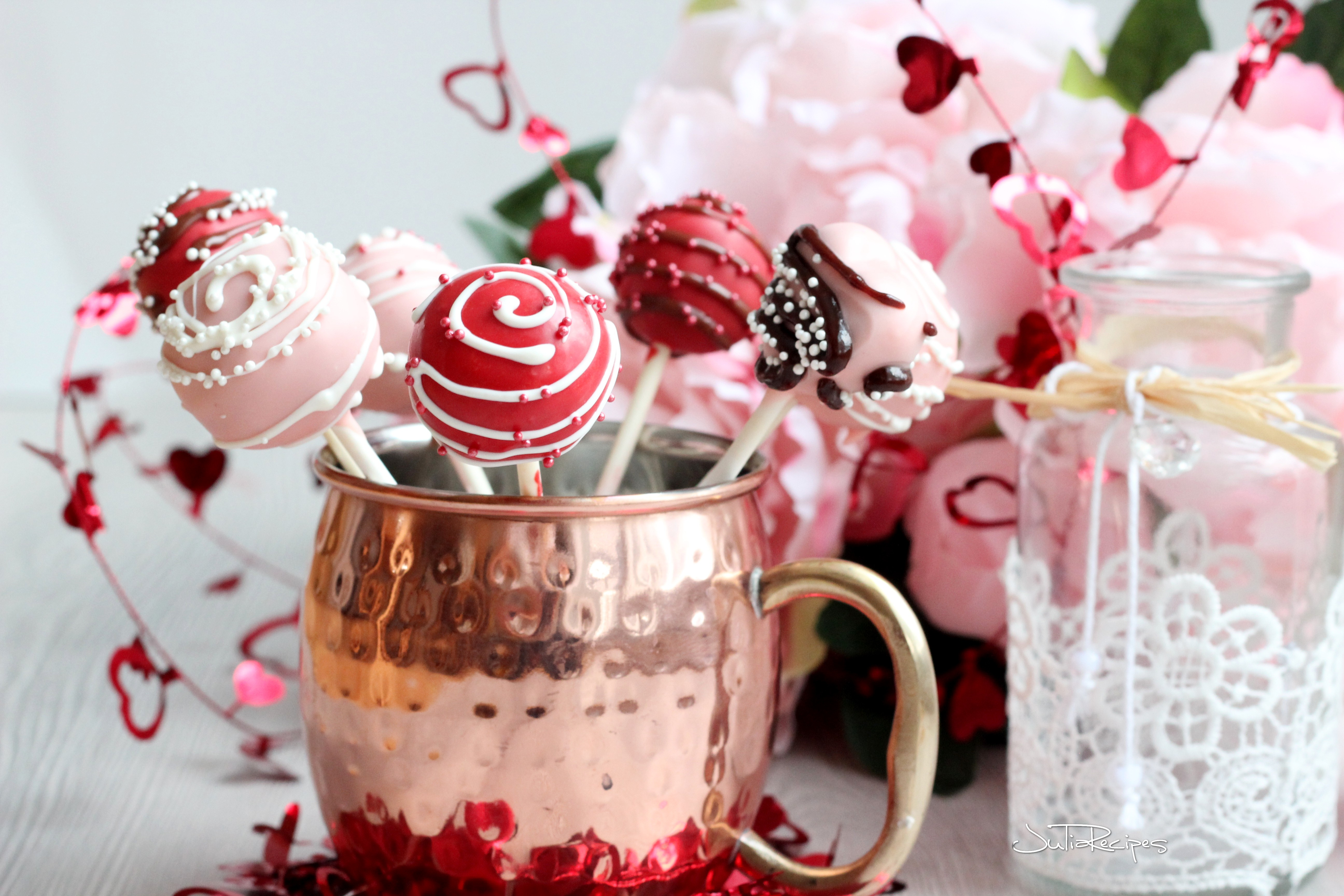 cake pops covered in candy melts in mug