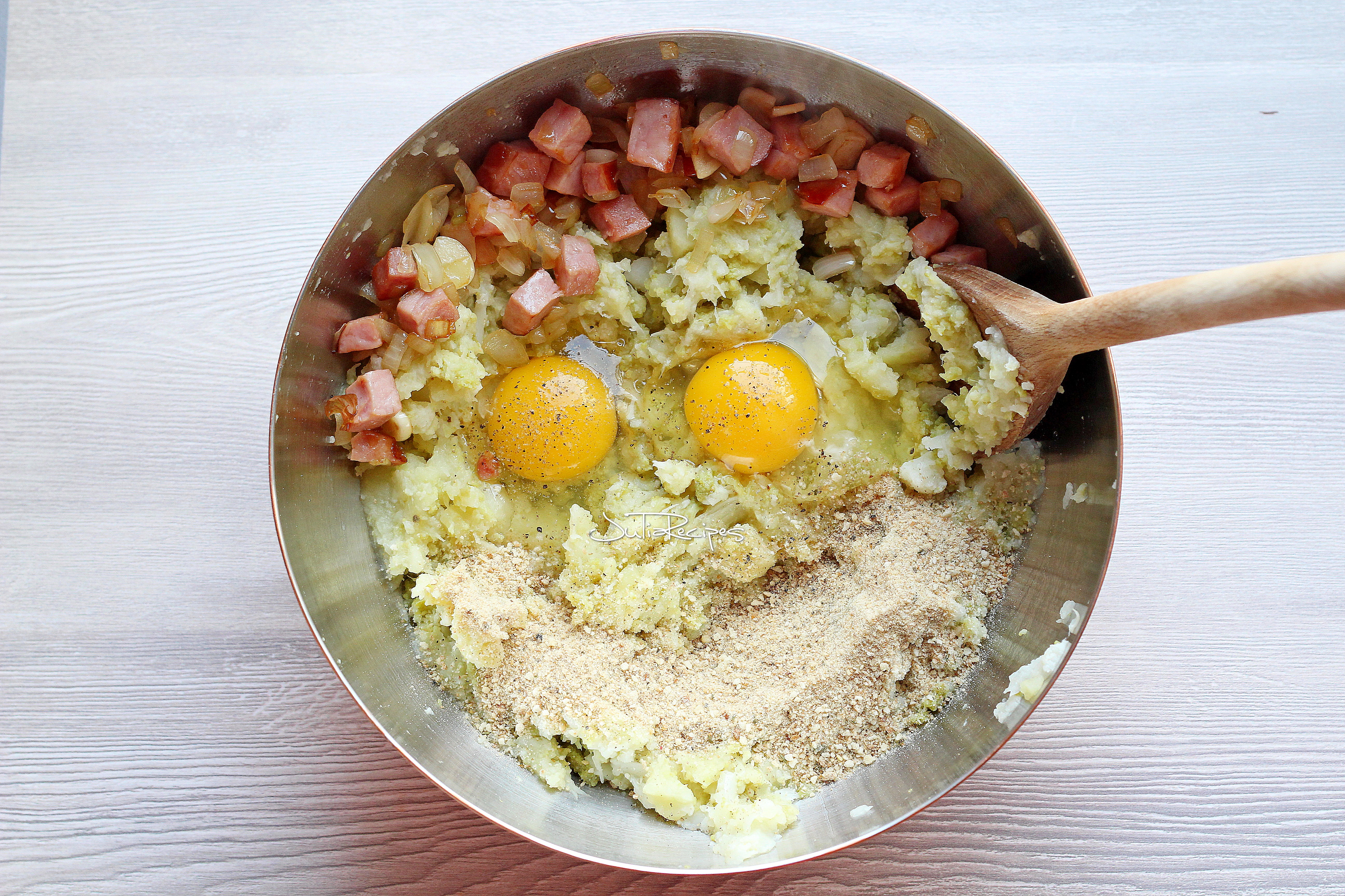 Bowl with mashed cauliflower ham eggs and breadcrumbs