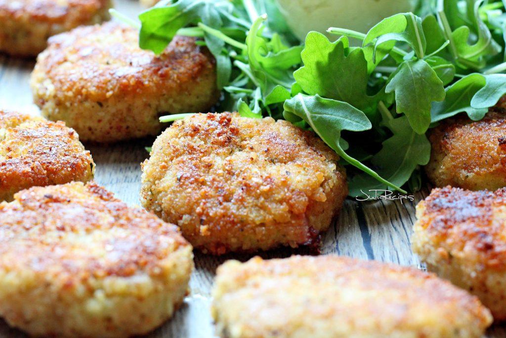 Cauliflower fritters on plate with arugula salad