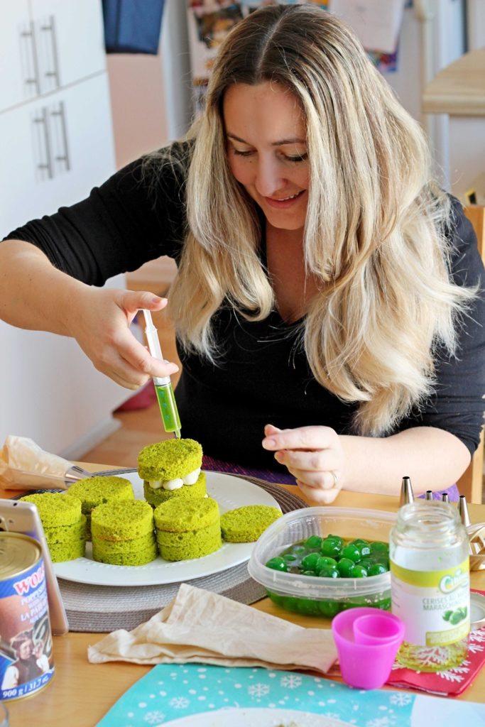 Julia making green mini cakes