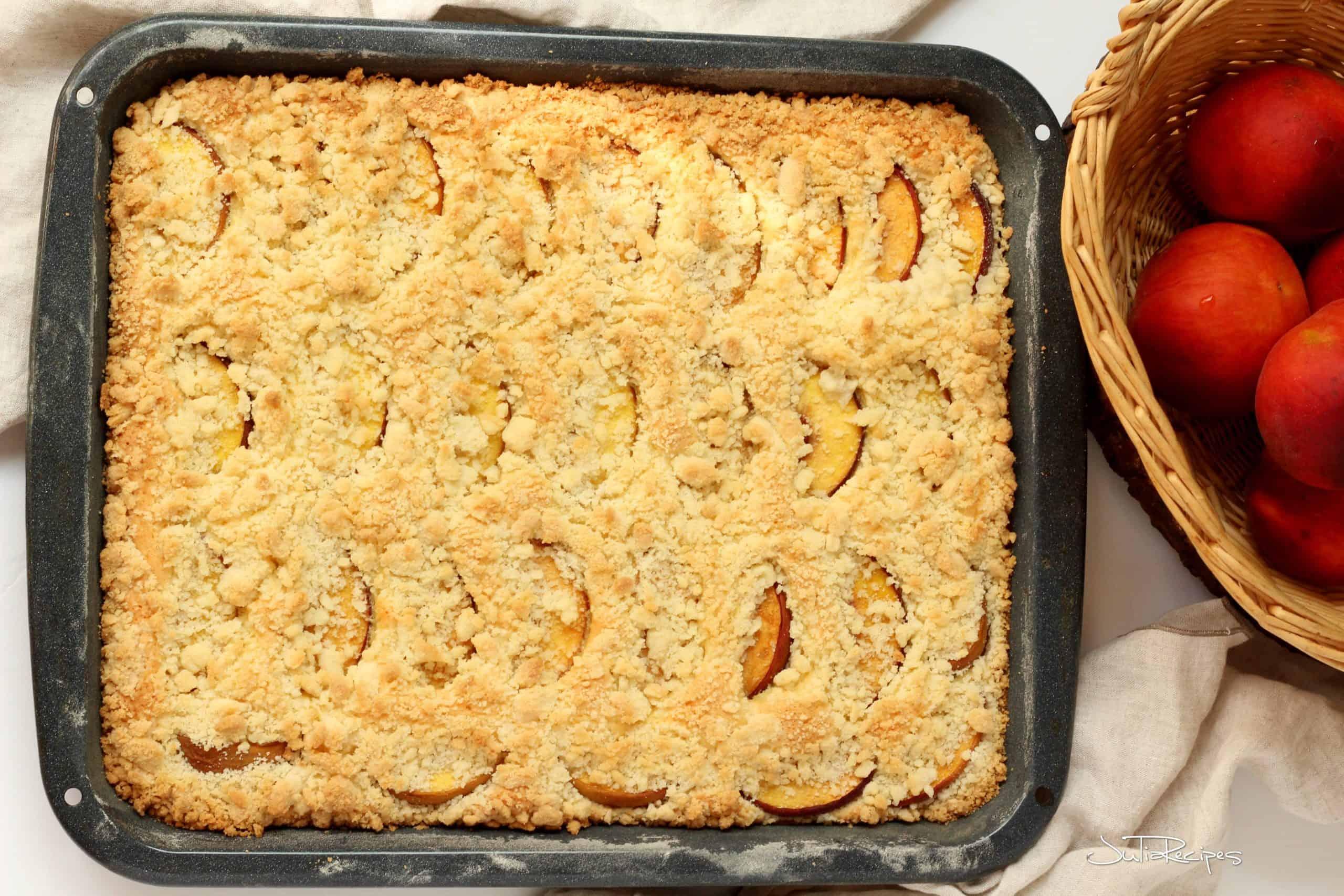 peach streusel bars in baking sheet