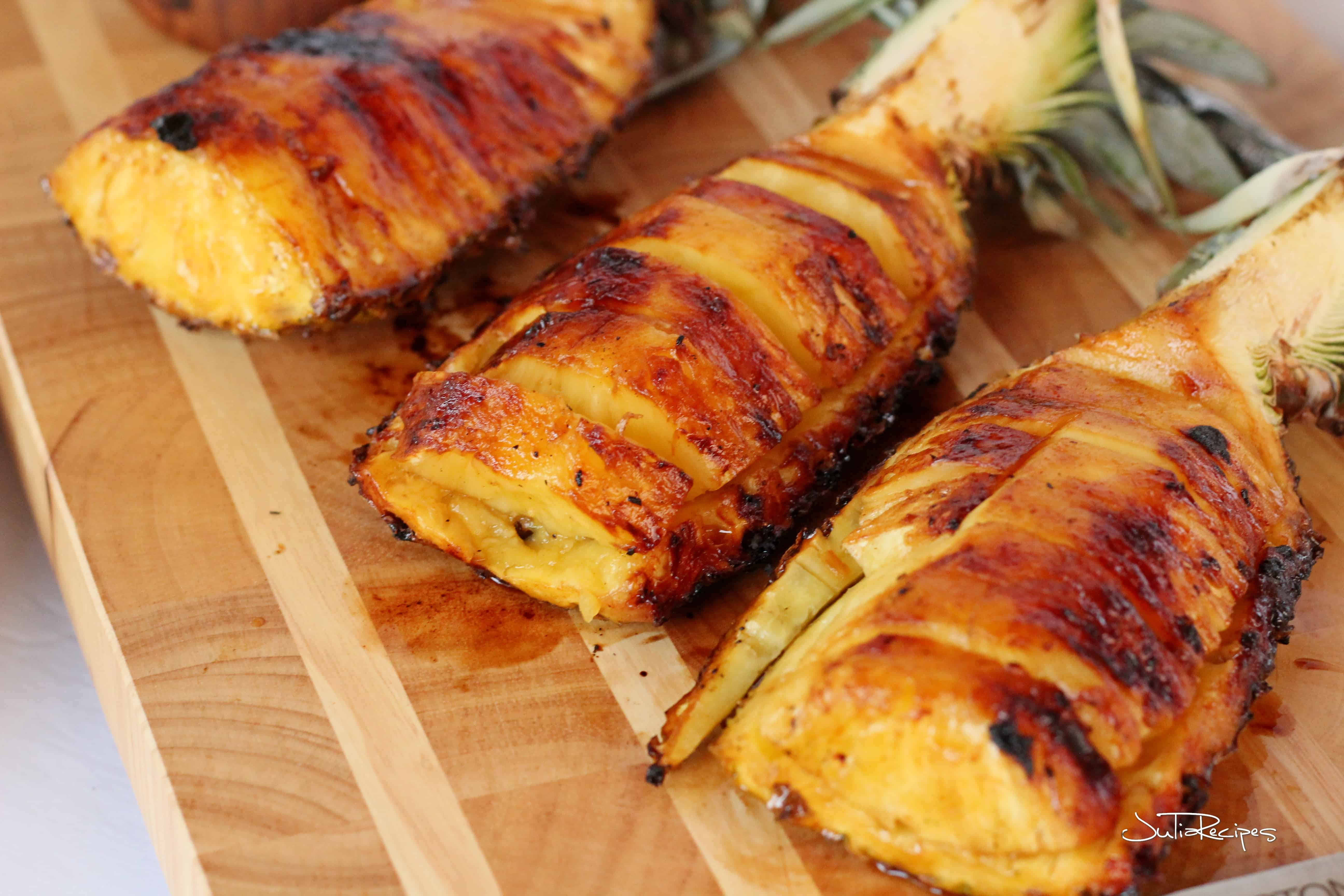 Grilled pineapple on wooden board
