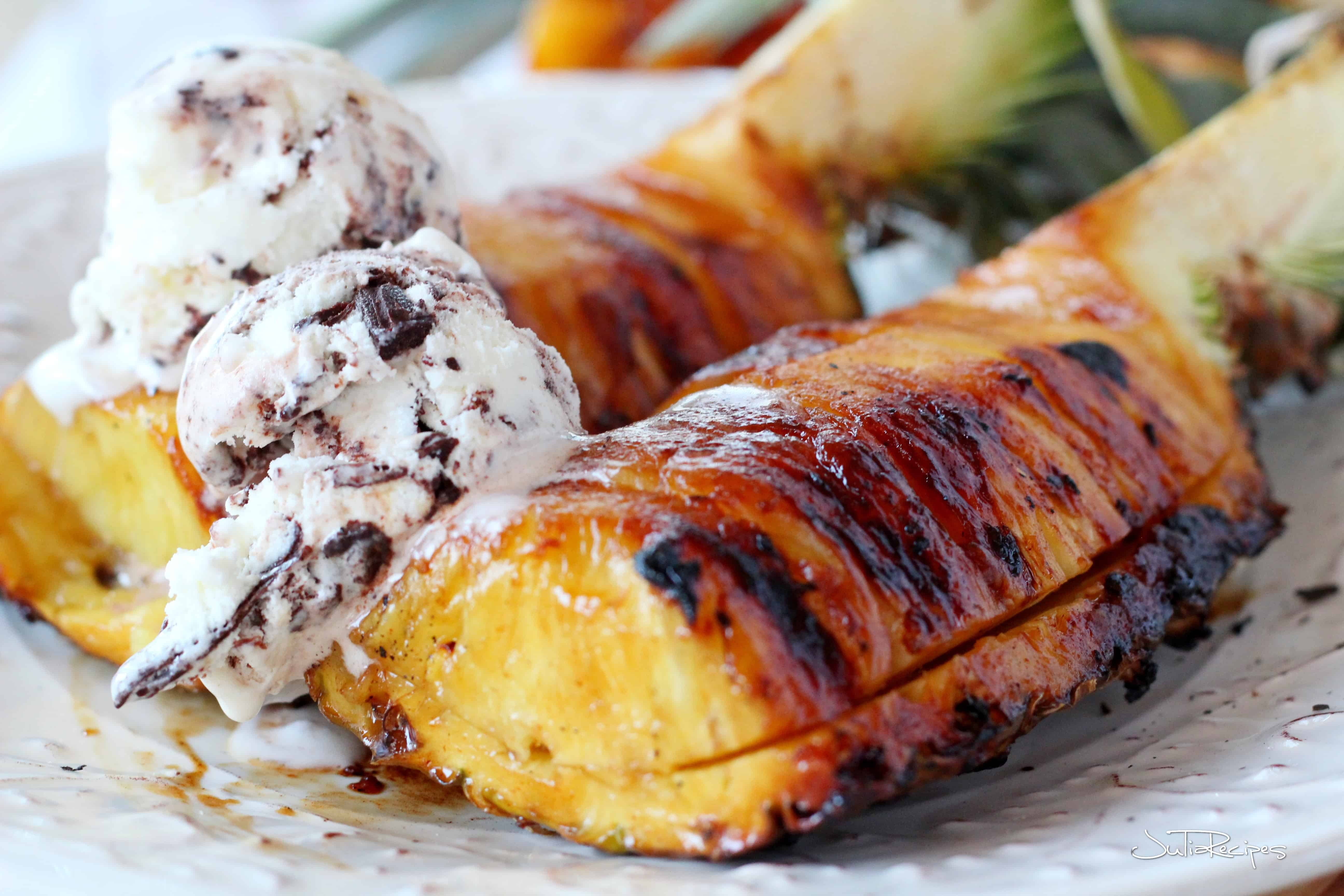 Grilled wedge of pineapple with scooped ice cream