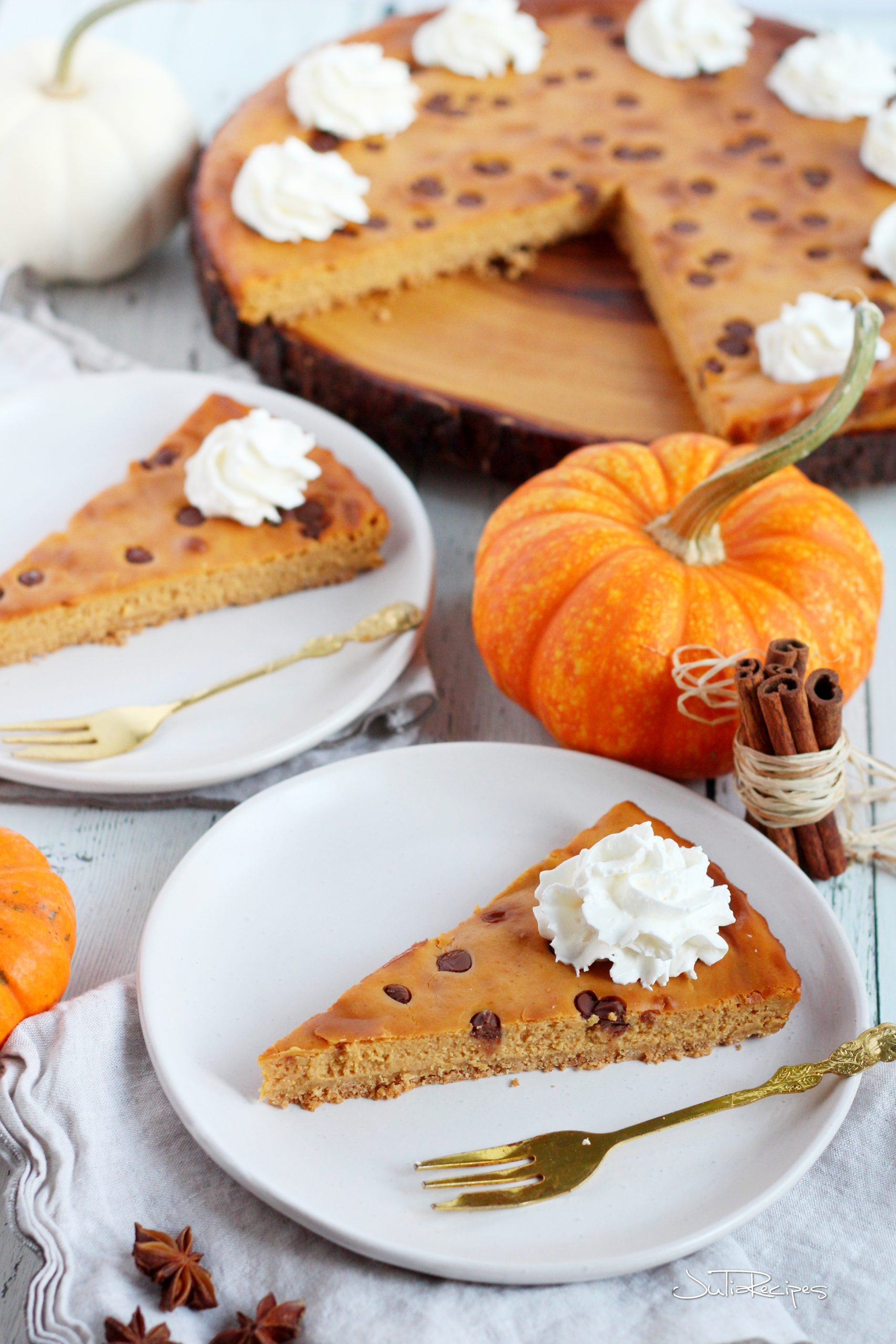 pumpkin spice cheesecake slices and place on white plates