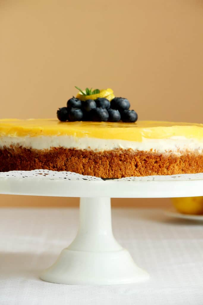 cheesecake with lemon curd on cake stand