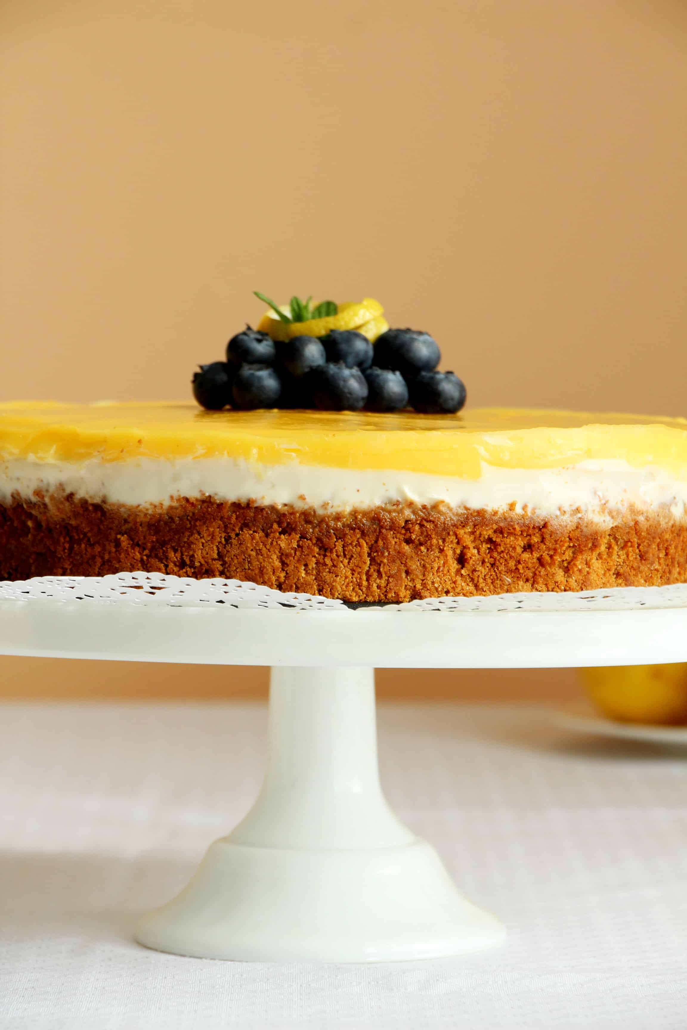 lemon cheesecake on white cake stand