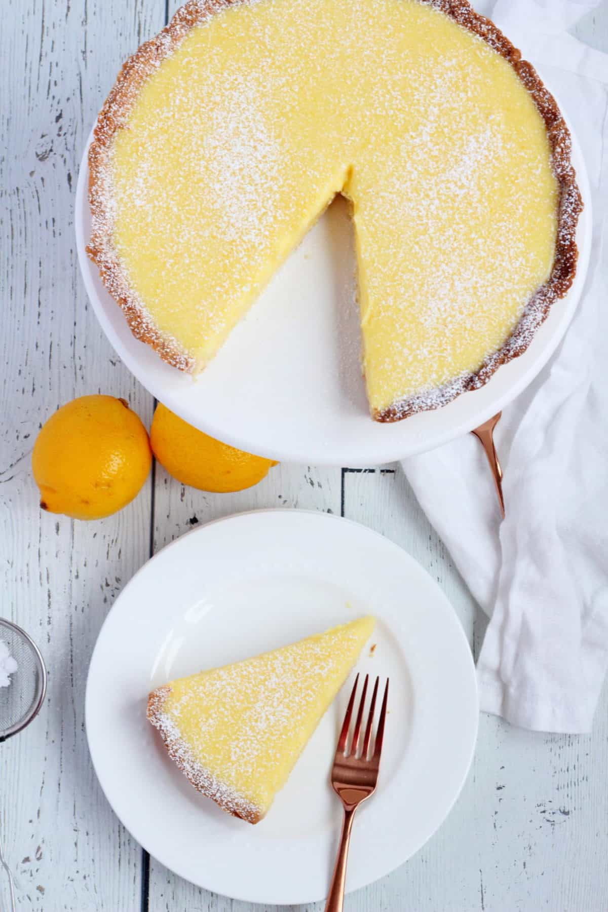 Lemon tart slice on white plate