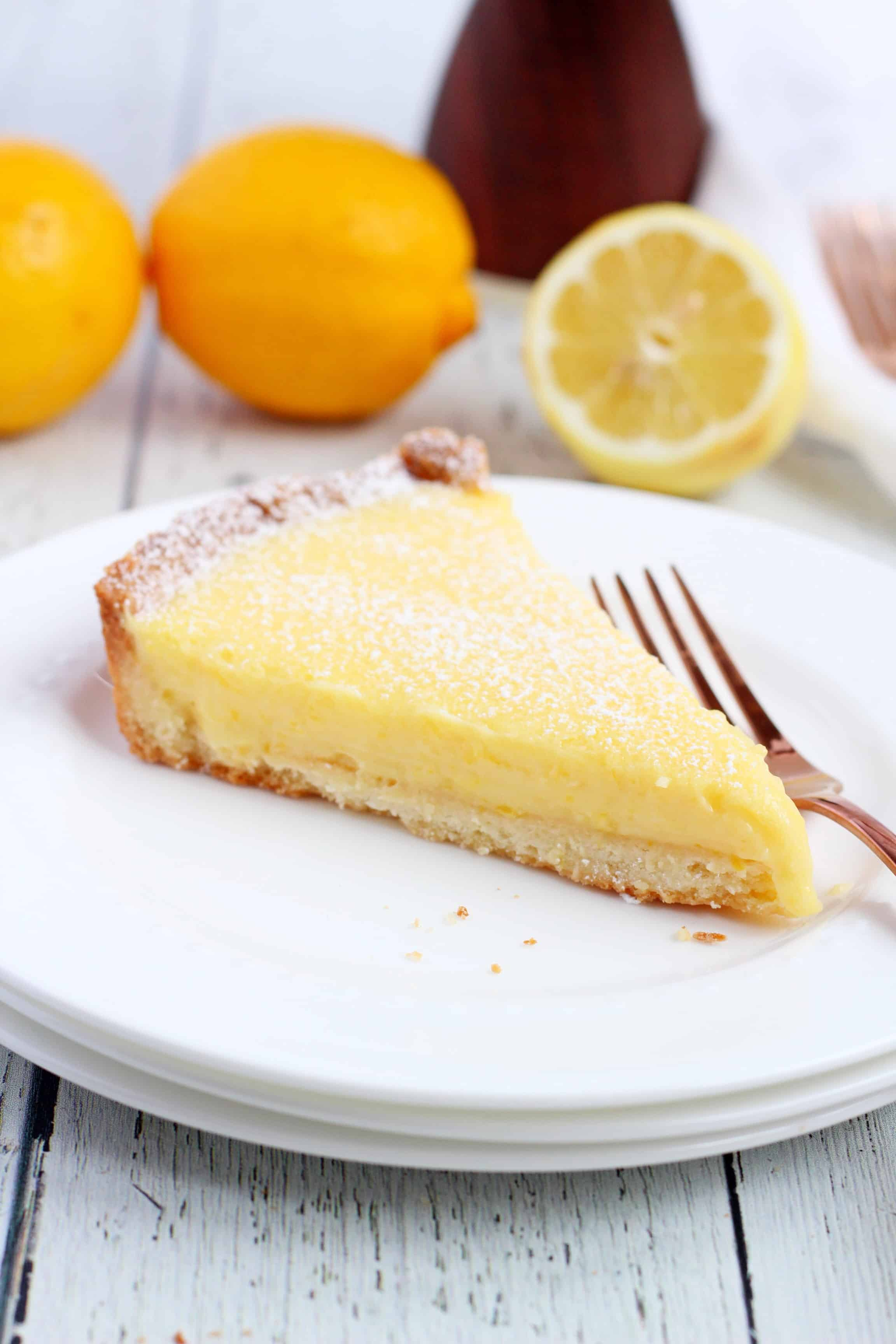 Lemon tart slice on two white plates