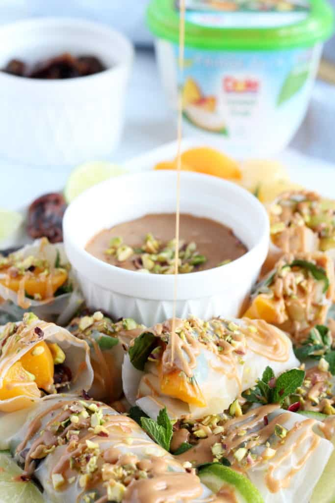 peanut butter drizzled on fruit spring rolls