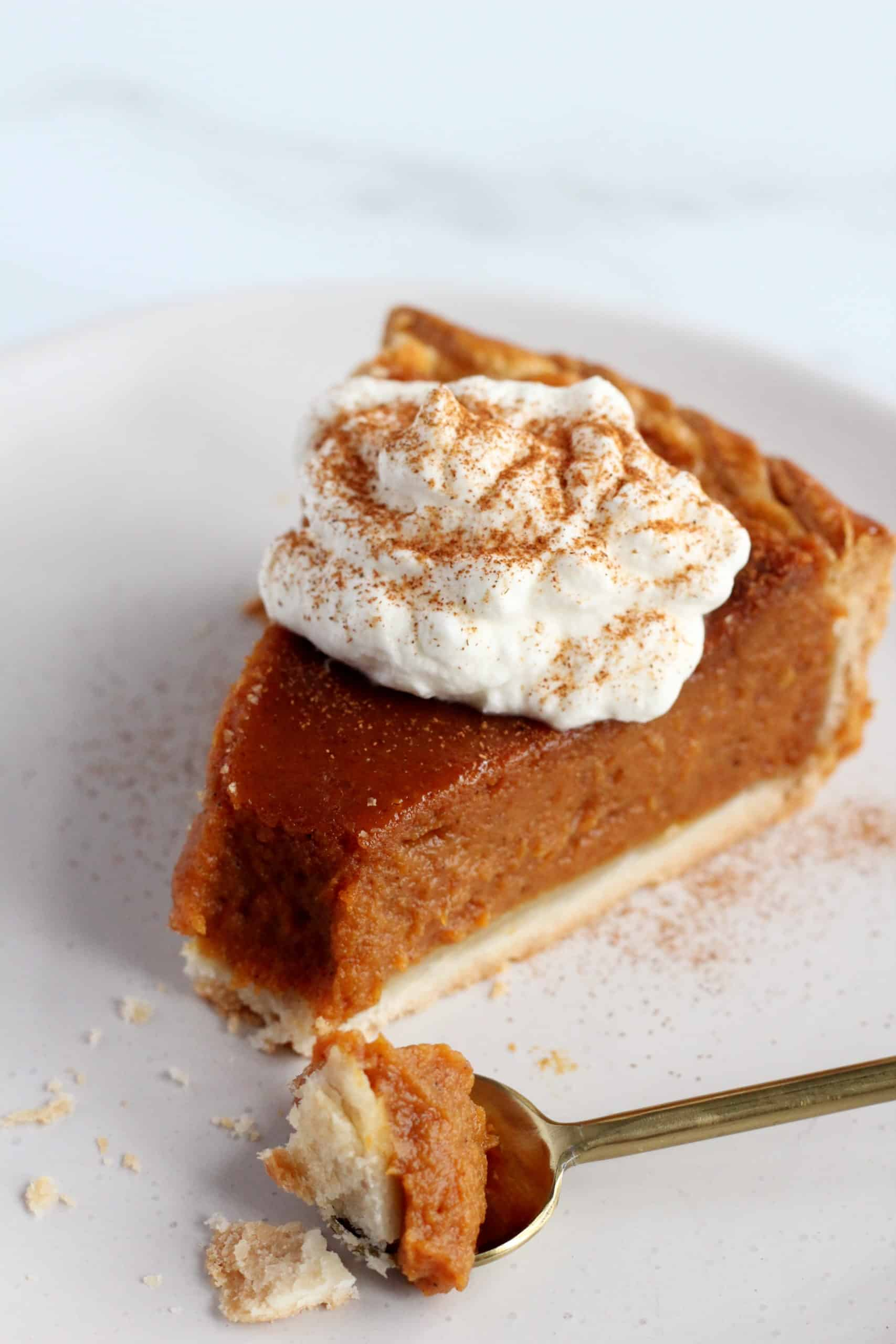 pumpkin pie placed on white surface with fall decoration