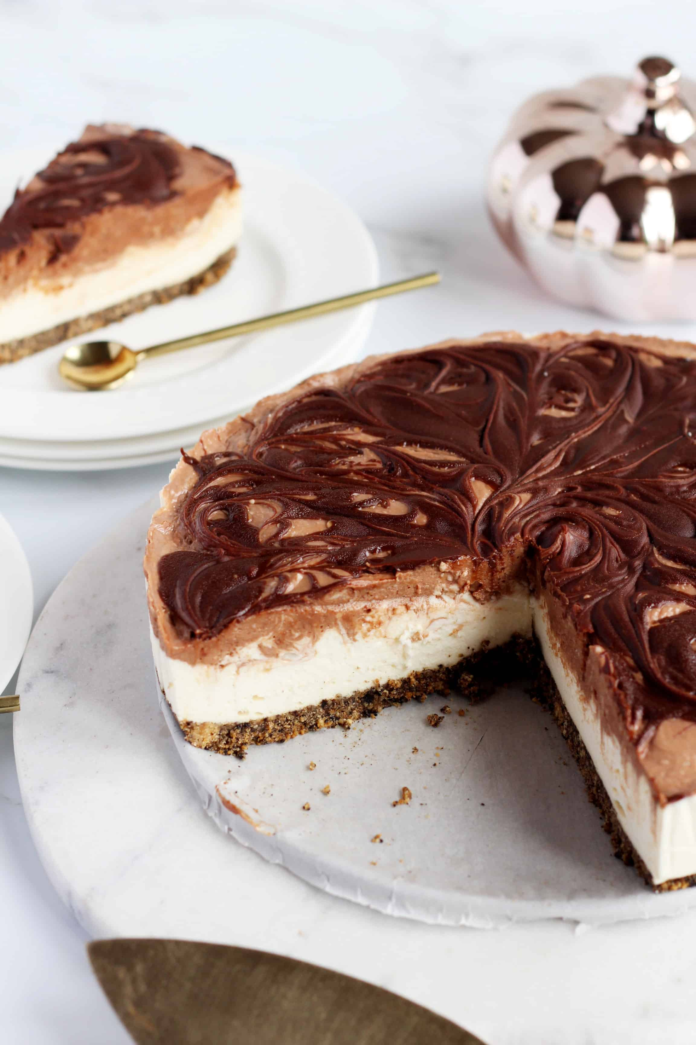 the whole chocolate swirl Cheesecake on marble plate