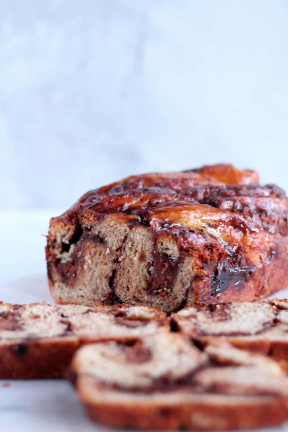 chocolate babka with almond filling cut in three slices