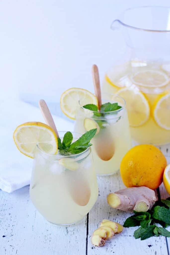 big jar with lemonade and two glasses