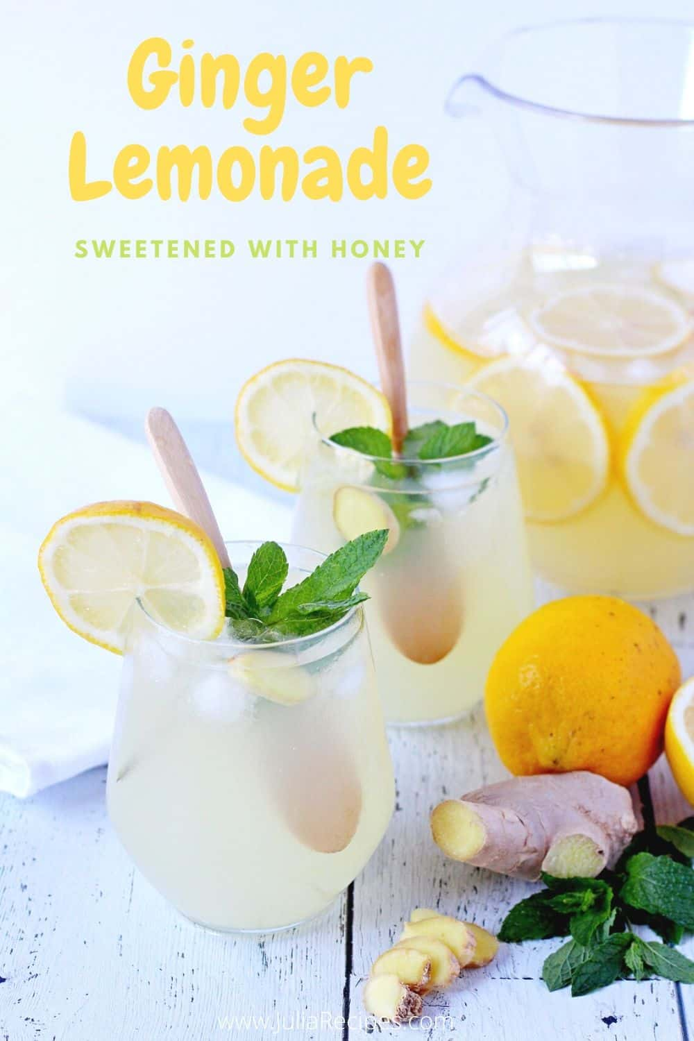 cups with refreshing lemon beverage