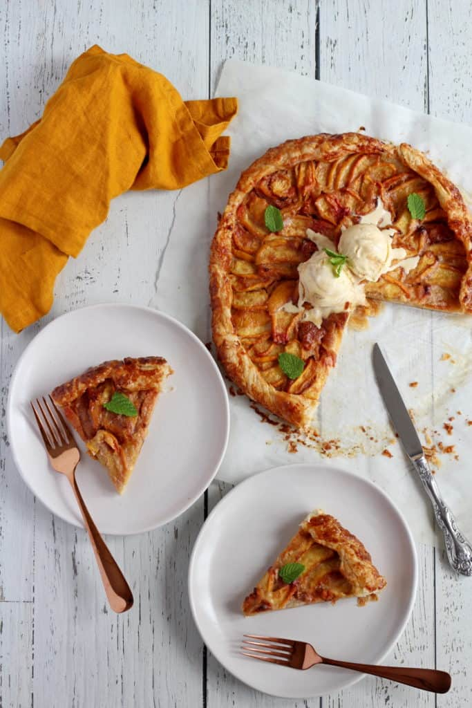 galette filled with peaches with two pieces cut out from the galette