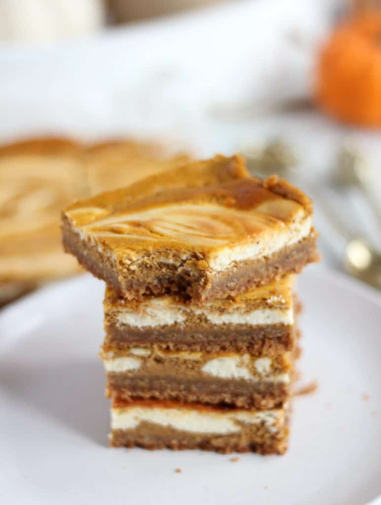 pumpkin cheesecake bars on top of each other
