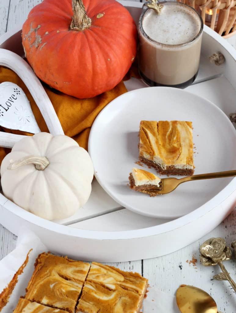 pumpkin cheesecake bar on white tray