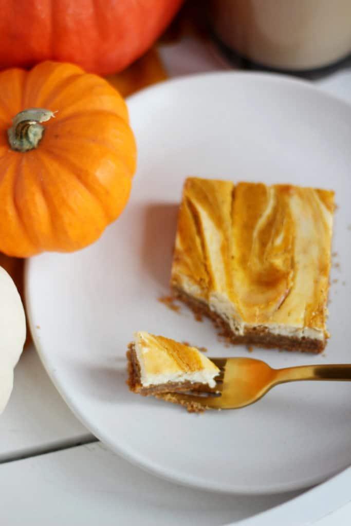 bite on fork of pumpkin cheesecake bar