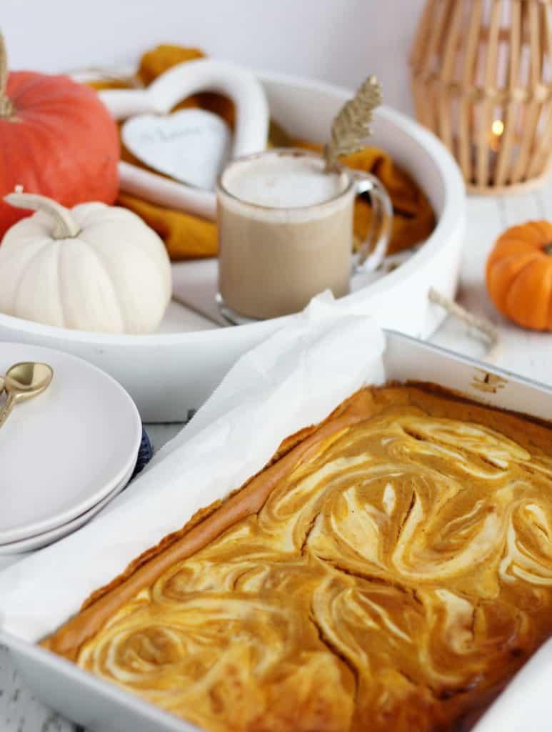 pumpkin cheesecake bars in baking pan