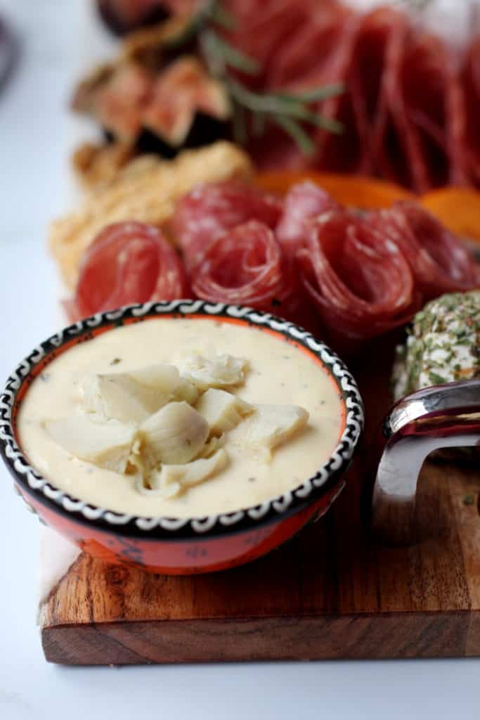 artichoke dip on charcuterie board