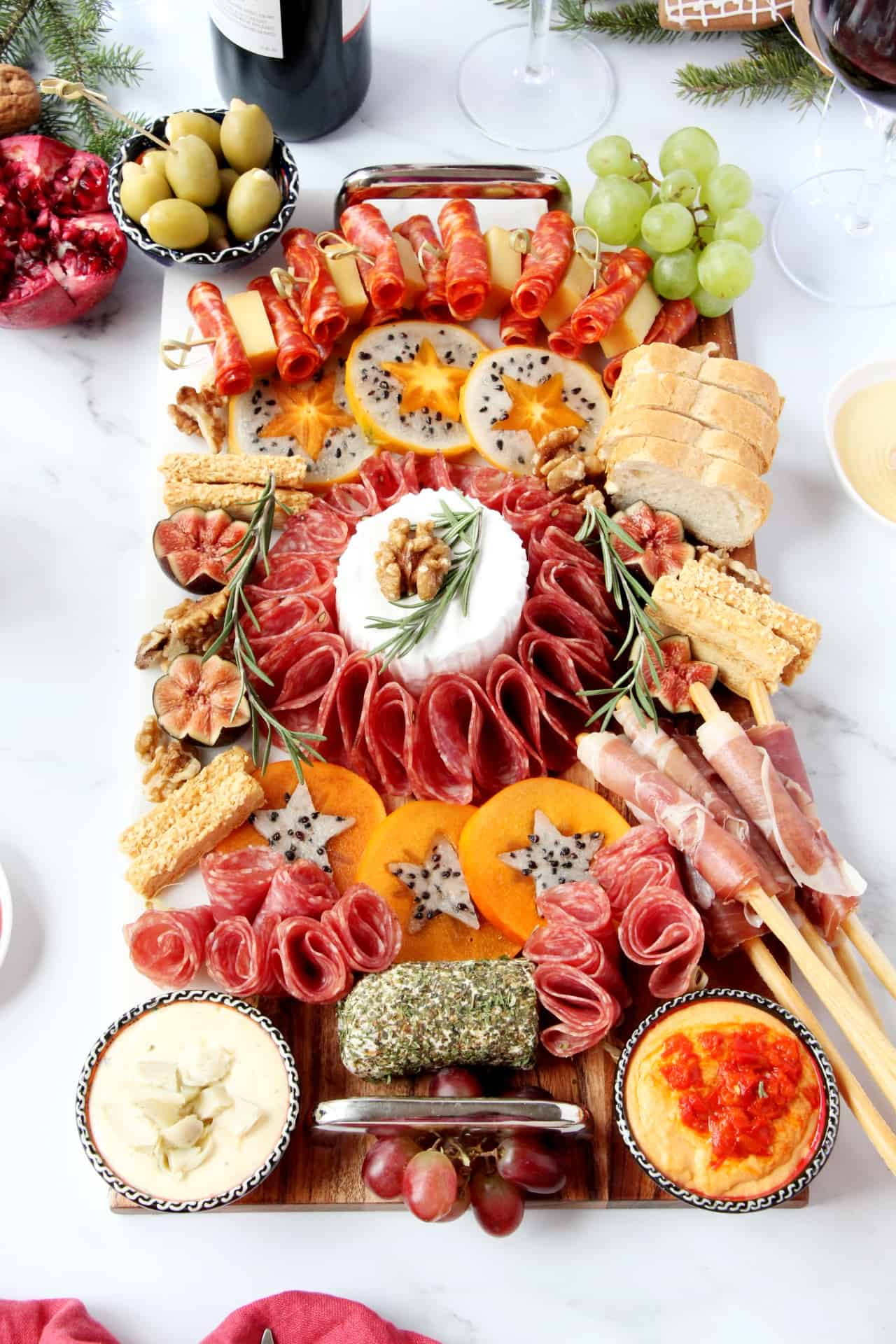 charcuterie and cheese board with fruit and dips
